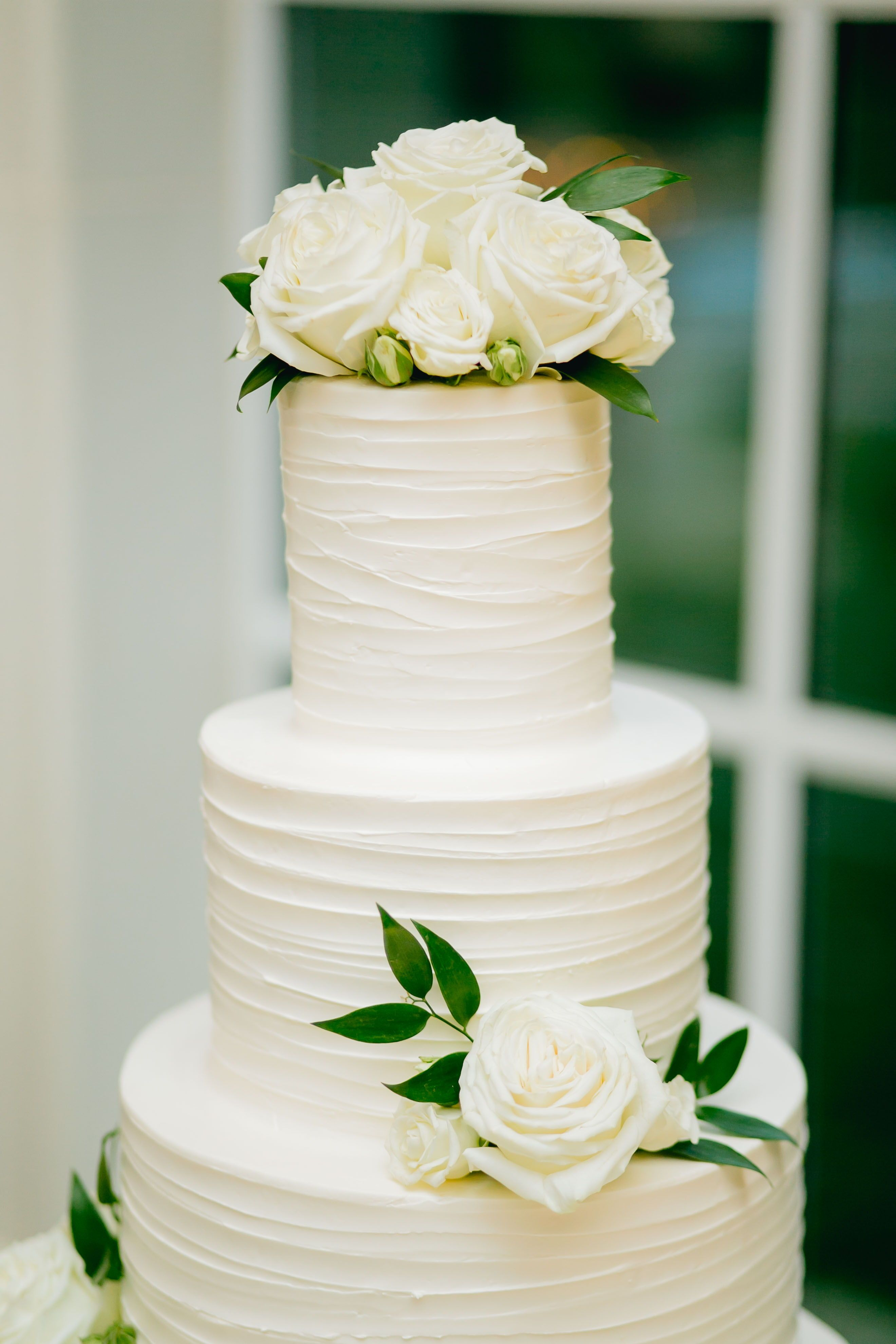 This stunning and modern all white wedding cake was made even more ...