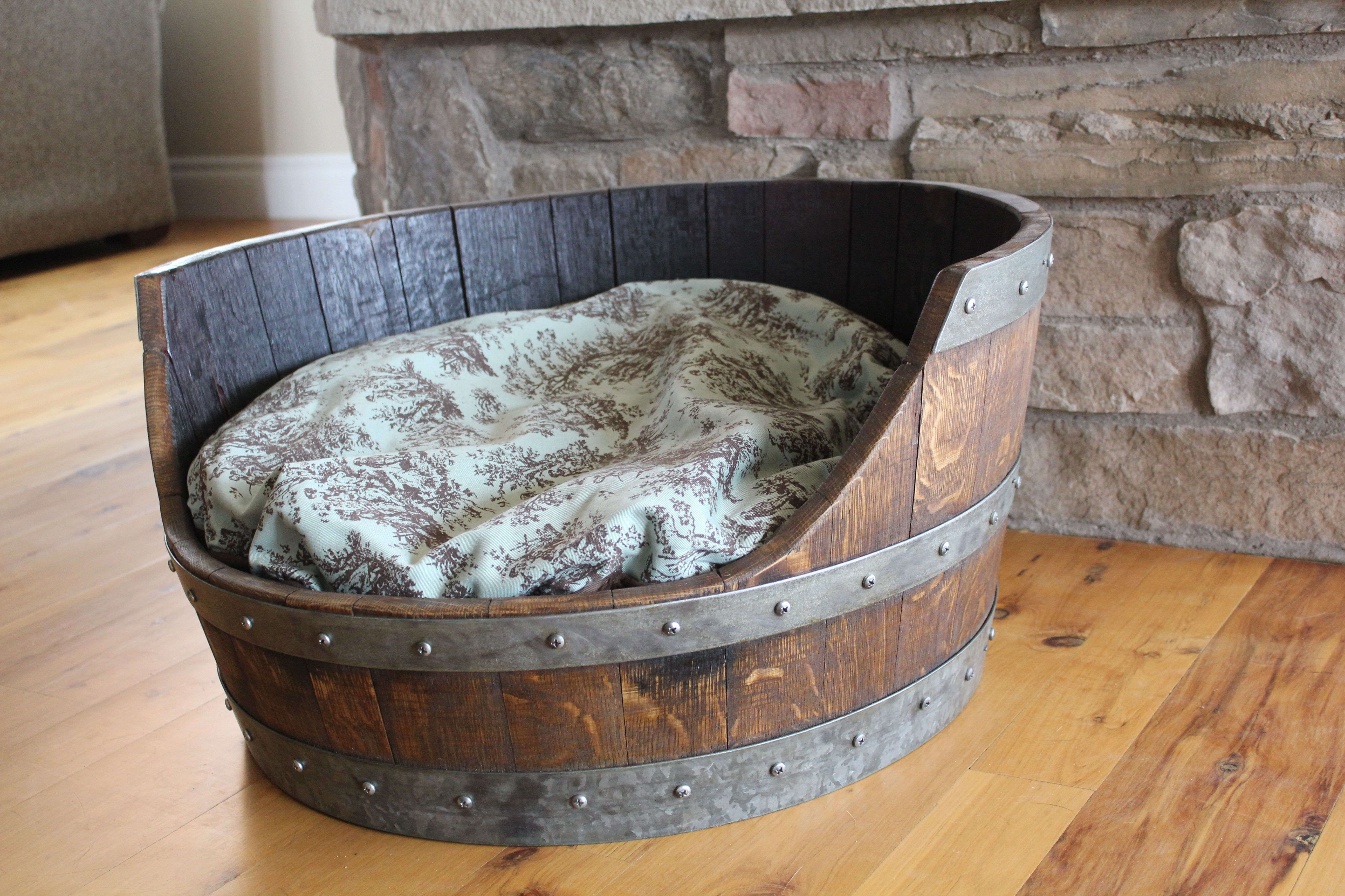 Wine Barrel Dog Bed with a turquoise pillow!