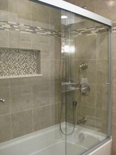 accent tile higher on wall compliment but different tile in niche small bathroom shower with tub tile design bing images