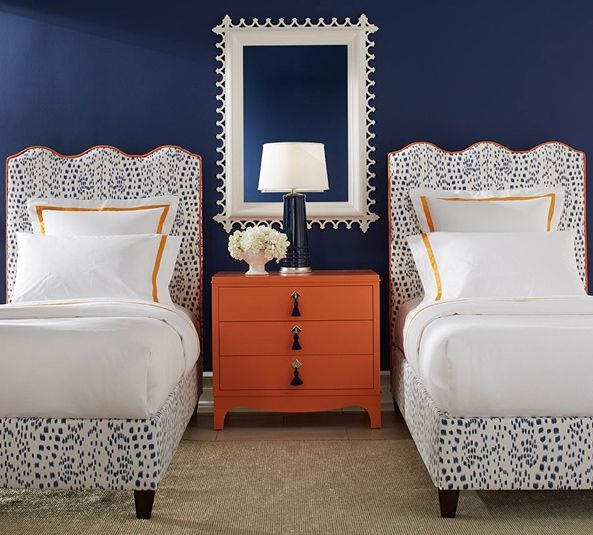 A room with oomph. Wave platform beds, nightstand, lamp, and mirror.