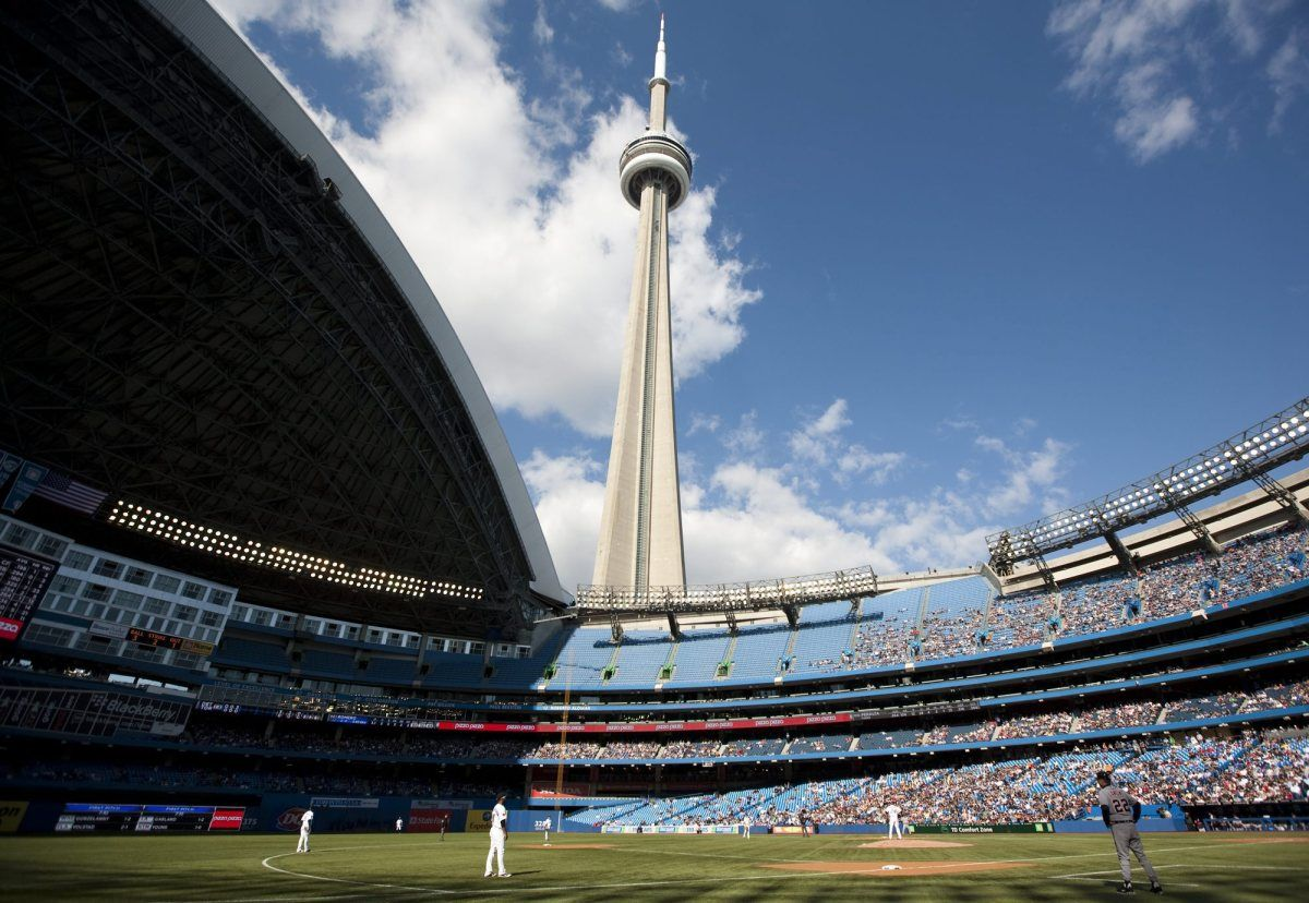 rogers centre toronto with the cn tower in the. Black Bedroom Furniture Sets. Home Design Ideas