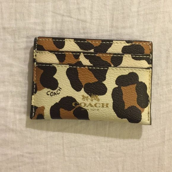 Coach Leopard Cardholder Only defect as shown. Still in good condition Coach Accessories Key & Card Holders