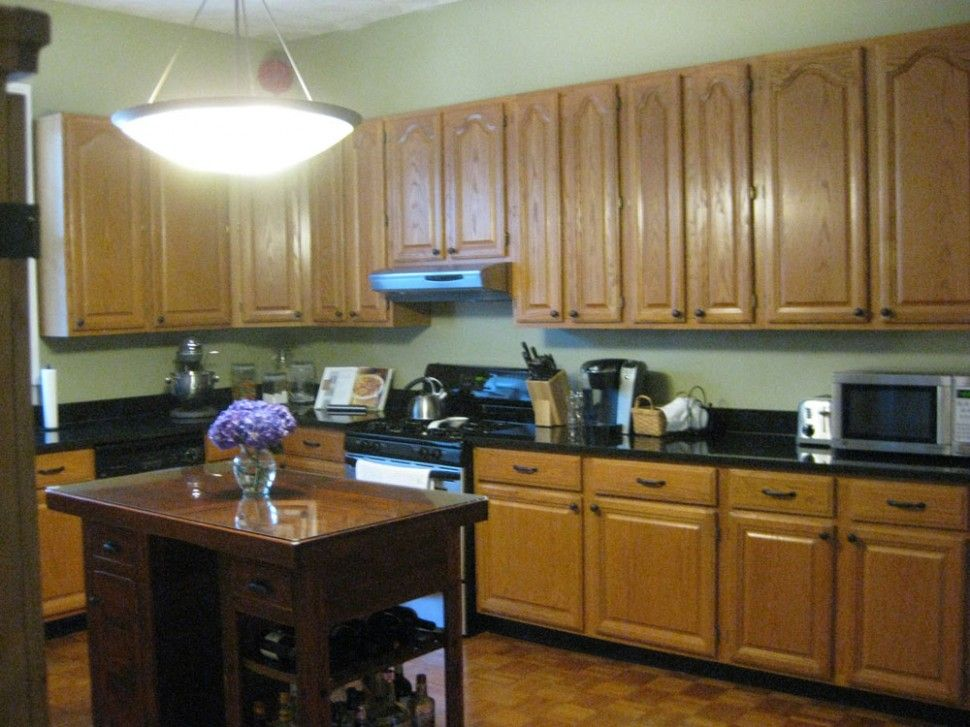 Black countertops with golden oak cabinets black for Black kitchen cabinets small kitchen