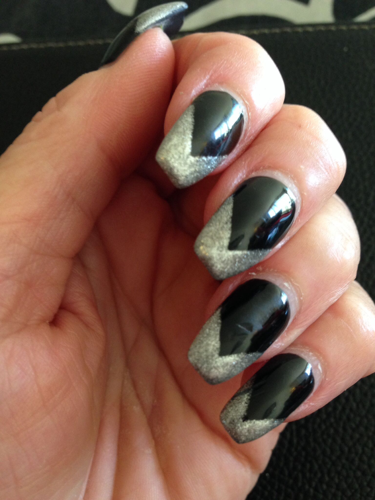 Black with silver nails. this nail design gives the nails a stiletto ...