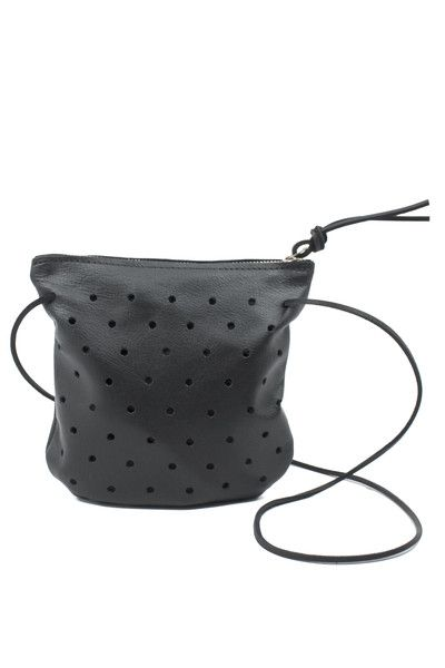 This Punched Pouch is handmade in Seattle, WA! It converts from a handheld clutch or organizer to a light and easy cross body bag! www.mooreaseal.com