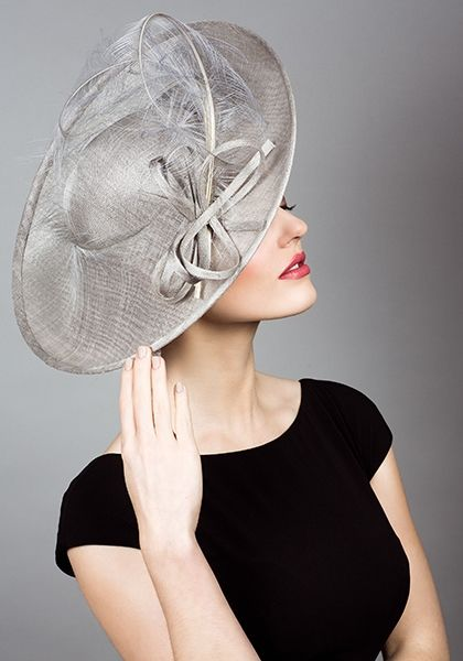 Fine straw sidesweep hat with sweeping ostrich feathers