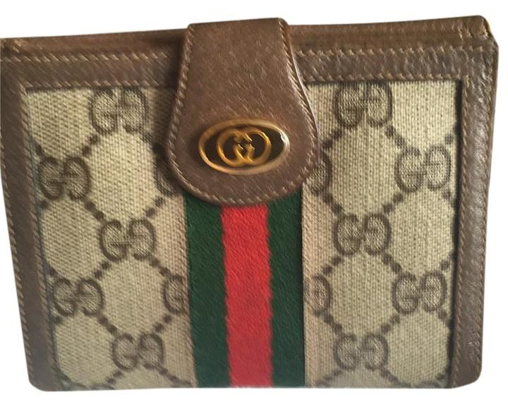962994c06a7044 Gucci Wallet GG Monogram. Free shipping and guaranteed authenticity on Gucci  Wallet GG Monogram at Tradesy. Pre-loved vintage Gucci women's wallet  leather ...