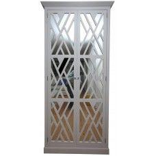 Cabinet with doors in trellis and mirror.  Designed by Ana Cordeiro.  Website: http://pregosemestopa.pt