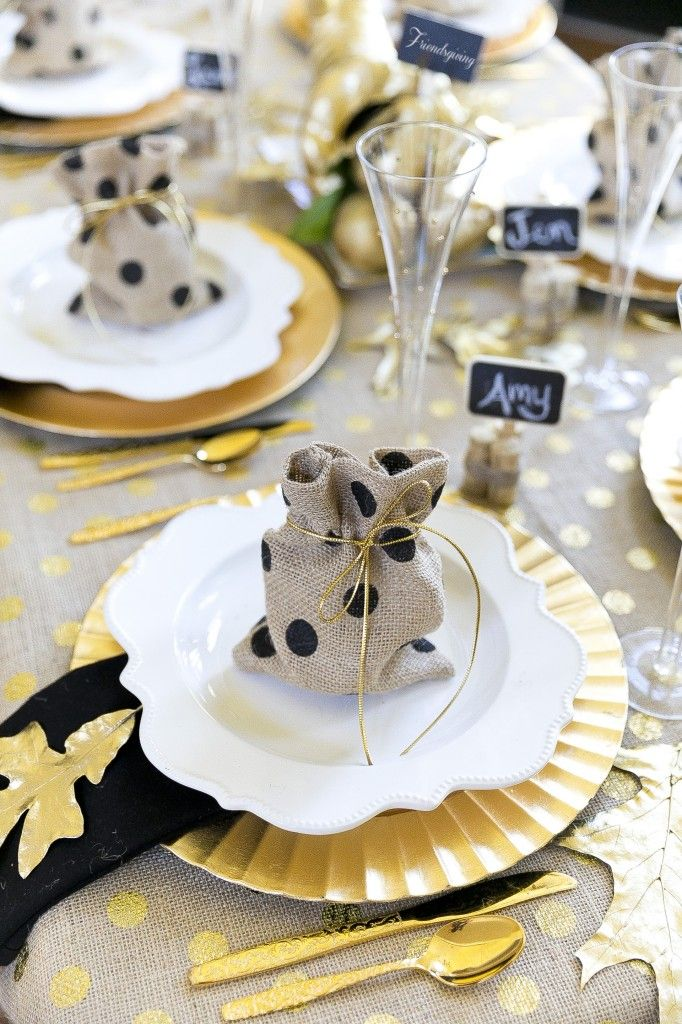 Host a Friendsgiving Party | Homes.com - burlap and gold makes a glamorous tablescape for Thanksgiving!