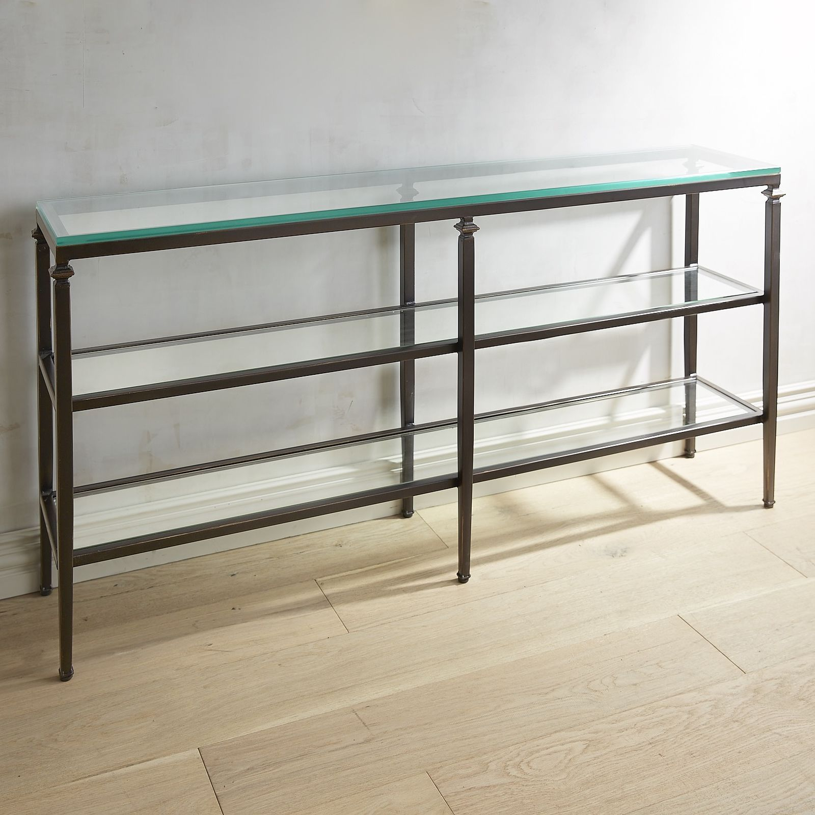 Our Oversized Console Table Has A Slender, Bronze Colored Wrought Iron  Frame And Clear