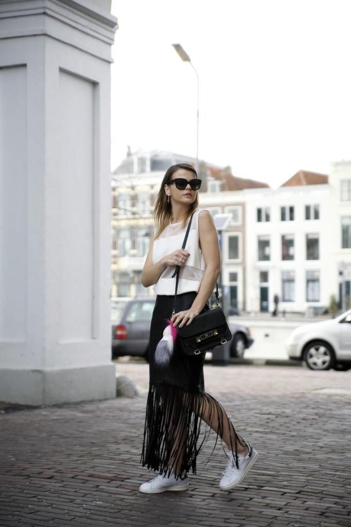 20 Inspiring Outfits That Show You How to Rock Fringe This Spring - black pencil skirt with long fringe hem paired with white sneakers