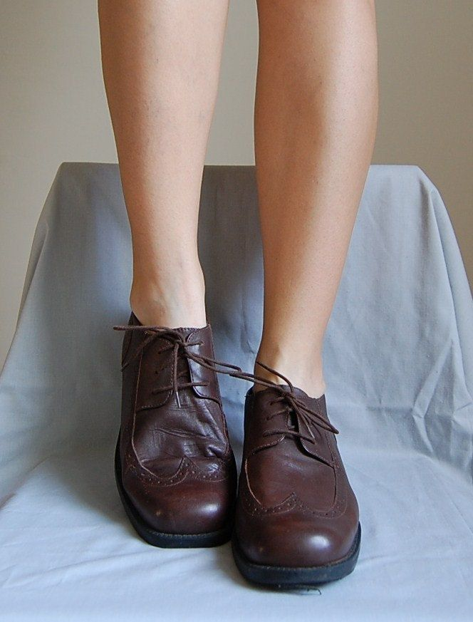 The Alice In Wonderland Spectator Oxfords...vintage 1980s chestnut brown leather boots 10. $45.90, via Etsy.