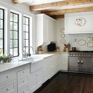 litchfield designs kitchen - exposed wood beams, wood panel, fridge