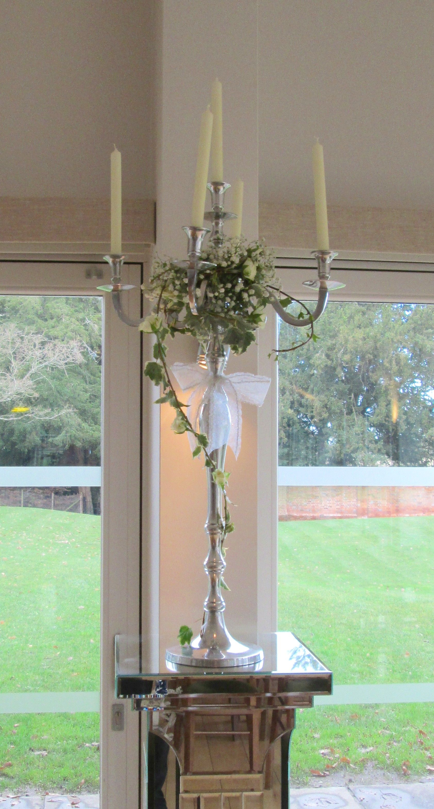 Candelabra with ivy, spray rose and gypsophila decoration