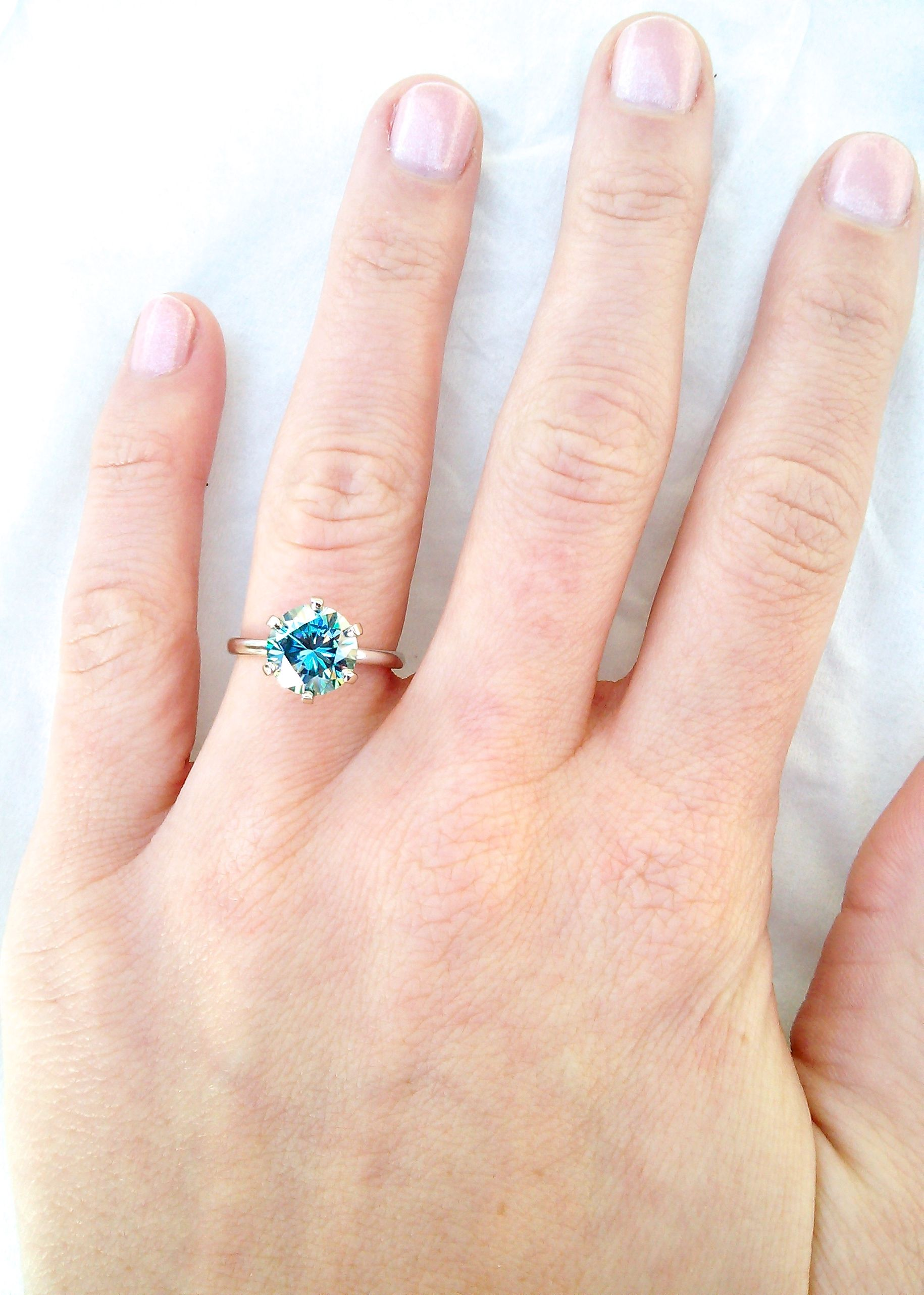 My Engagement ring! Blue Moissanite in a classic six prong tiffany ...
