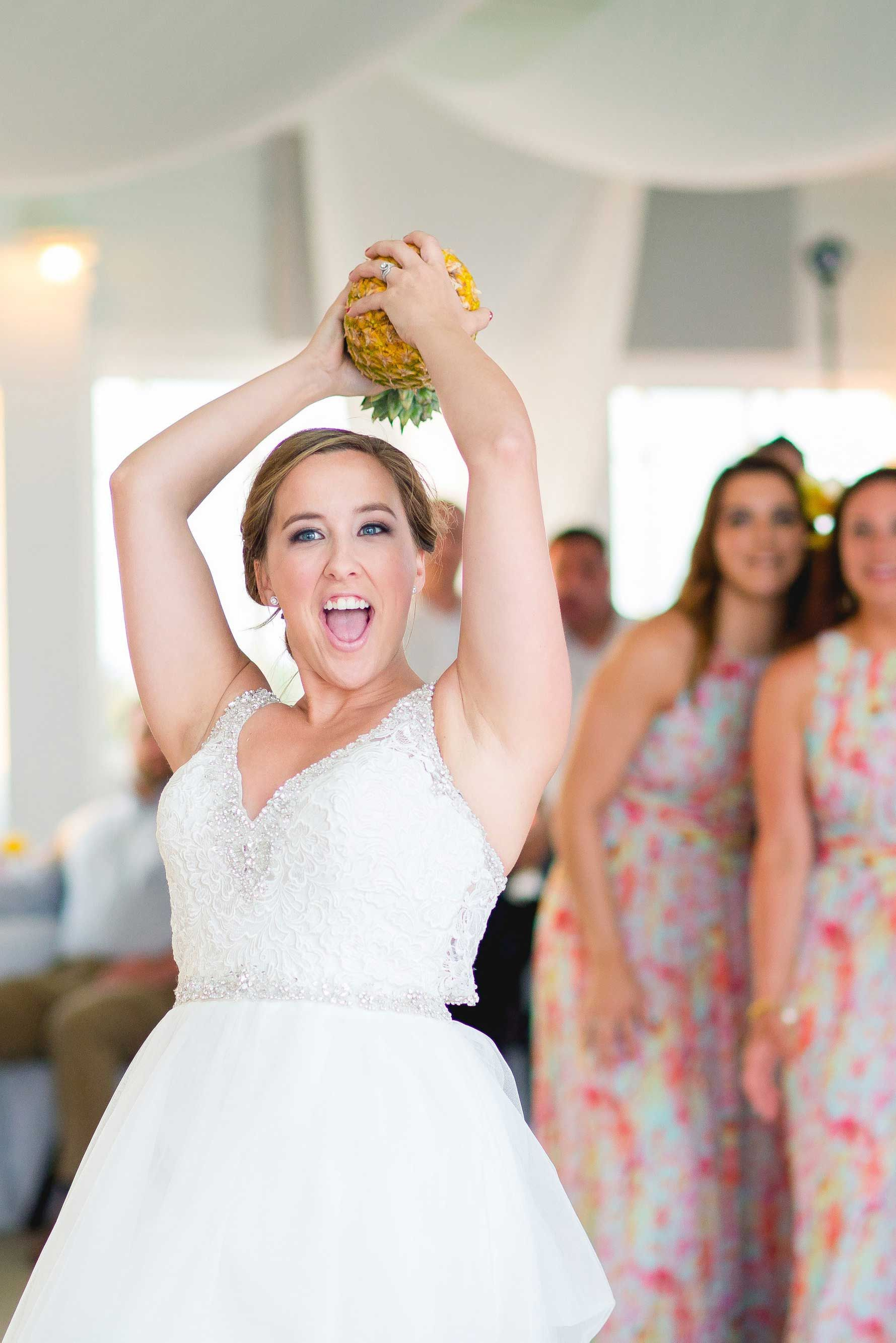 Forget a bouquet toss! This coastal bride opted for a pineapple instead.