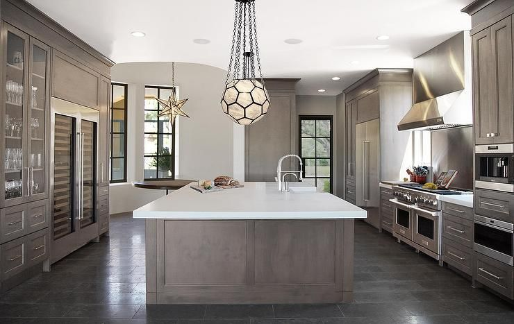 Contemporary Kitchen Cabinets Grey contemporary kitchen features gray wash island topped with thick