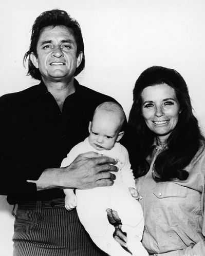 Johnny and June Carter Cash pose with their their son John Carter Cash in 1970.