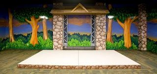 Worlds of Wow - a themed step-up stage and background mural at Lighthouse Christian Fellowship in Prosper, TX.