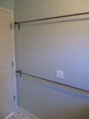 Use Stacked Curtain Rods In Laundry Room To Hang Dry Clothes Or To