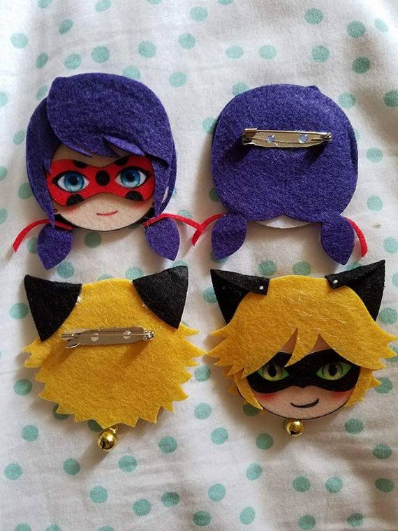 Miraculous Ladybug Felt Pins.  Available pins are: - Miraculous Ladybug - Chat Noir  Selling Price: 7 USD with 1 USD each shipping fee  Please pick one when ordering