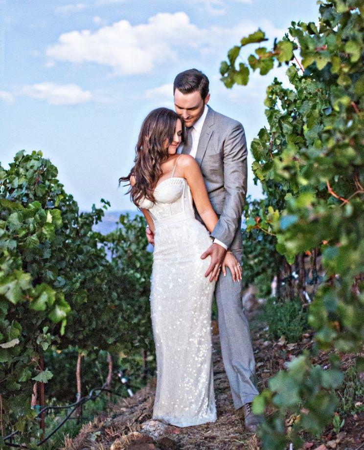 A wedding photo in the vineyards of Malibu. Photo by Joy Marie Studios.