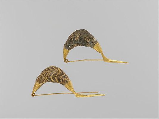Gold sanguisuga-type fibulae (safety pins) with glass paste bows Period: Geometric Date: late 8th–early 7th century B.C. Culture: Etruscan M...