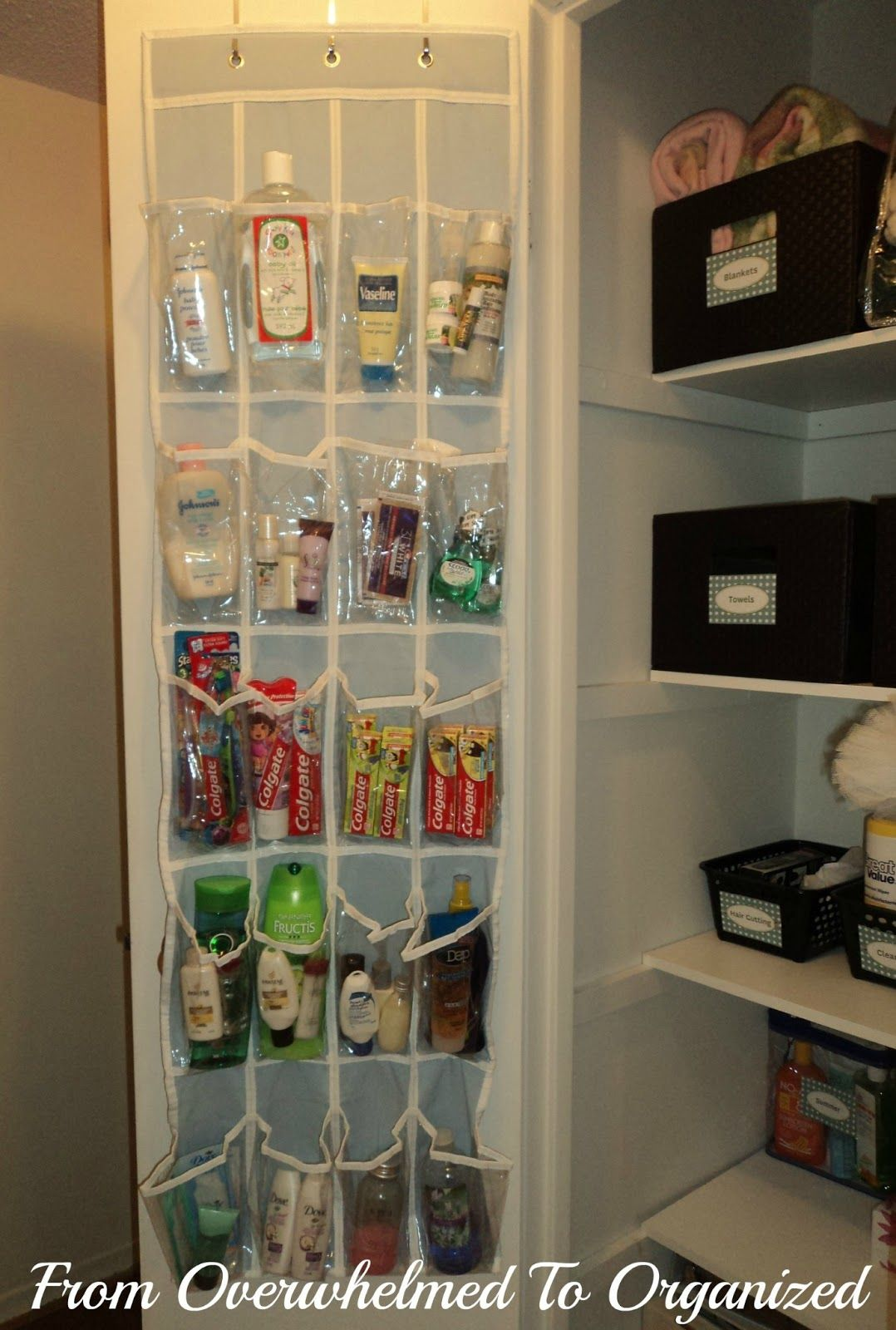 Bathroom cabinet door organizer - Organized Linen Closet Clear Over The Door Shoe Organizer Filled With Extra Bathroom