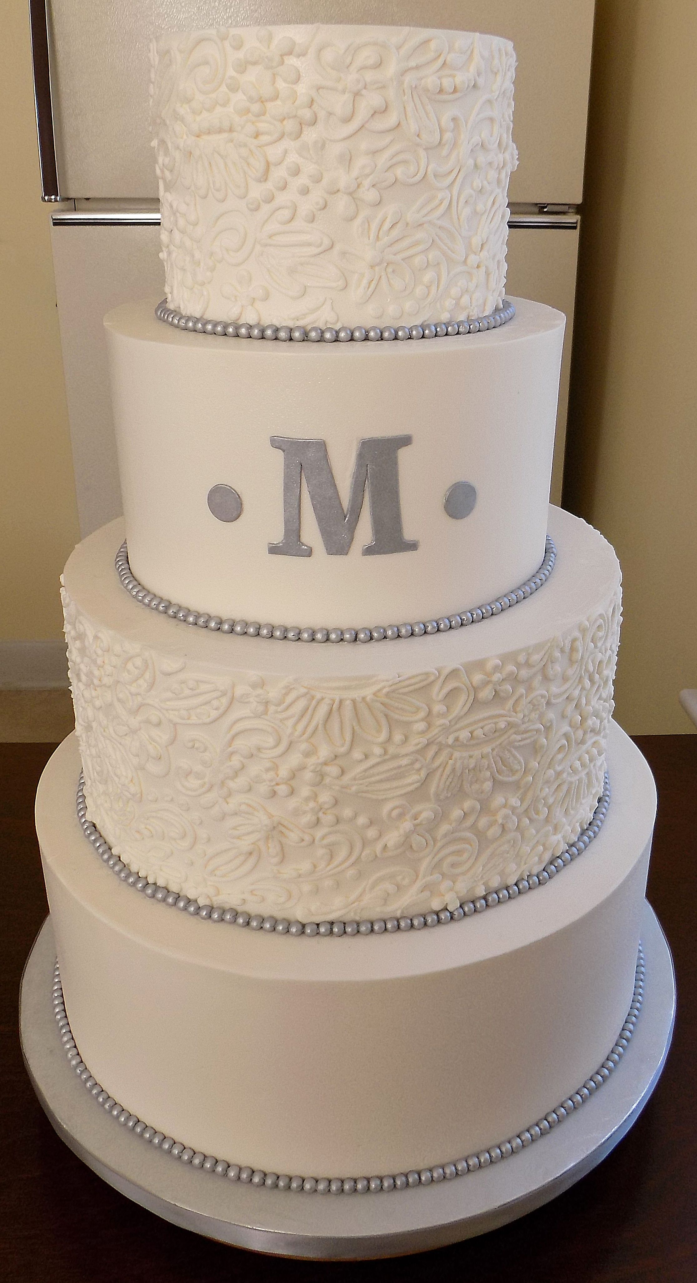 4 Tier Ercream Wedding Cake Decorated With Lace Designs Silver Fondant Pearl Borders