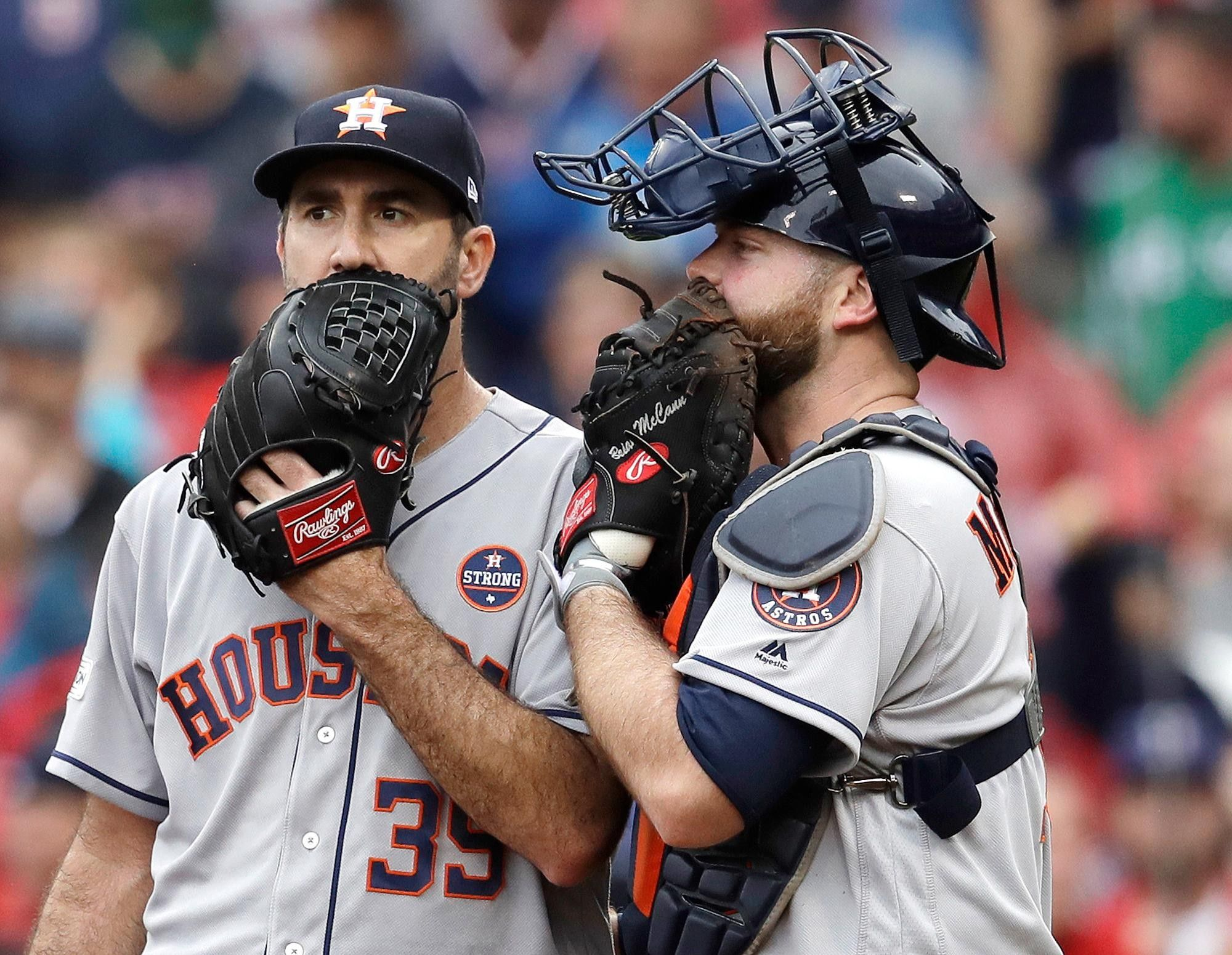 Houston Astros relief pitcher Justin Verlander, left, and