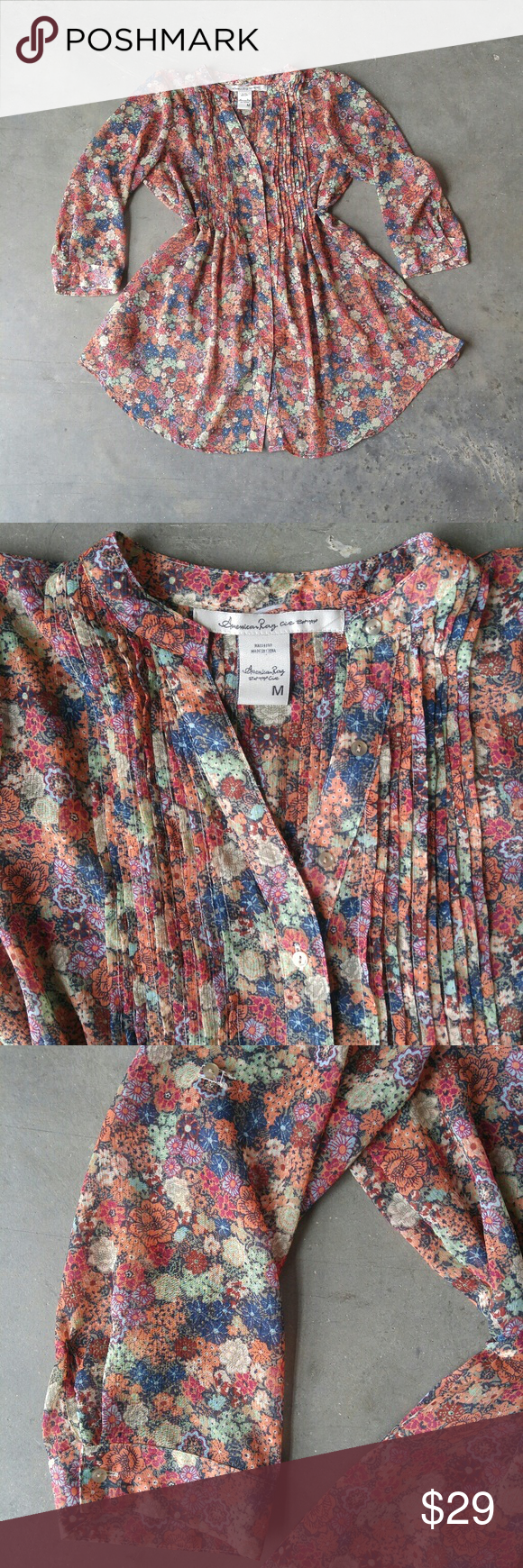 American Rag Button Down Floral Tunic American Rag blouse, size medium, in excellent condition! Sheer and floral print. Buttons down front. Tuxedo style pleats on front and back. Waist tie in back. Longer in front than in back because of waist tie. So perfect for spring! Please ask any questions. No trades. Make a reasonable offer. Thanks! American Rag Tops Tunics