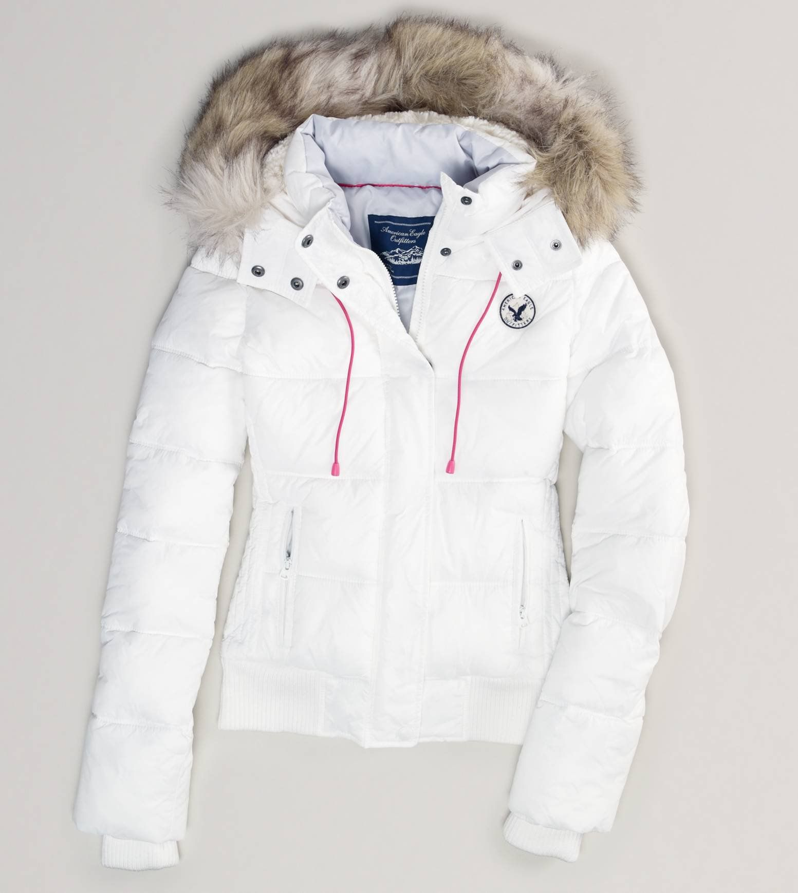 White puff jacket with no belt and brown fur hood