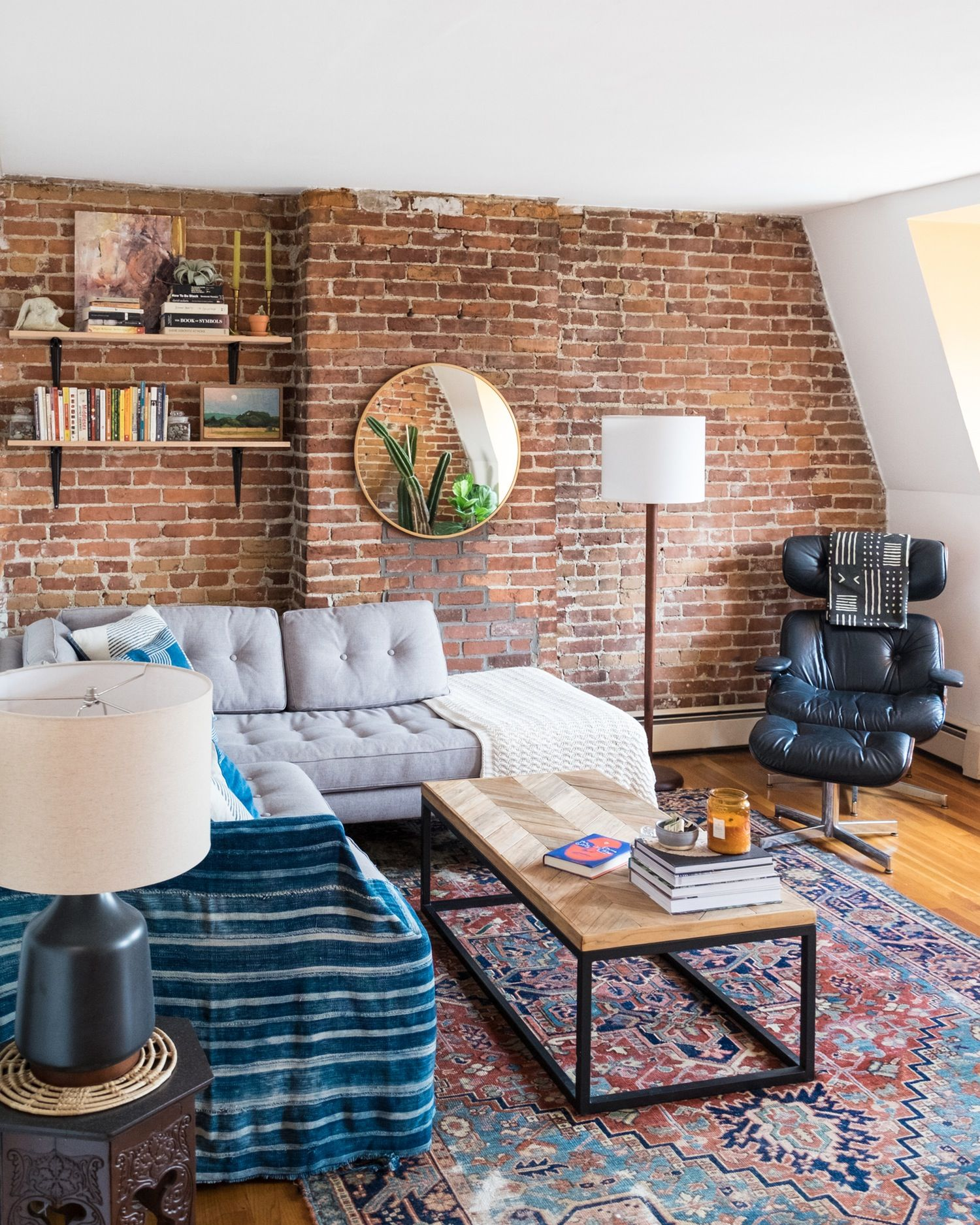 Get The Look Pared Down Comfort Brick Living Room Brick Wall Living Room Rugs In Living Room Living room brick wall