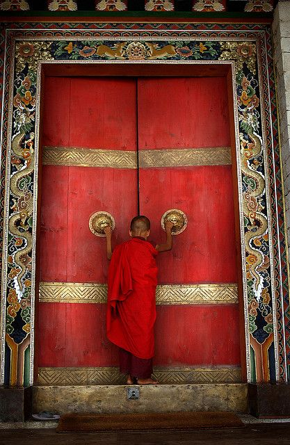 BHUTAN:THE LAST SHANGRI LA 2: A Buddhist monk enters the formidable doors of Trongsa Dzong, the Ancestral home of BhutanÕs monarchy. The Him...