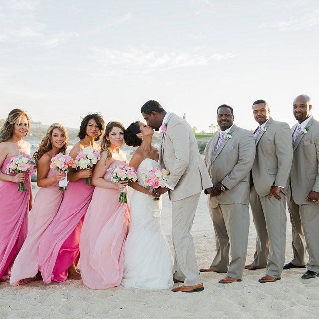 1bc8ca204b6f Bridesmaids wore a mix of pink and blush floor-length gowns while groomsmen  donned tan suits with brown shoes.