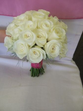 Google Image Result for http://www.flowersjust4u.co.uk/Images/Wedding%2520Bouquets/Bridesmaid%2520Head%2520to%2520Head%2520Akito%2520Rose%2520Handtied.jpg