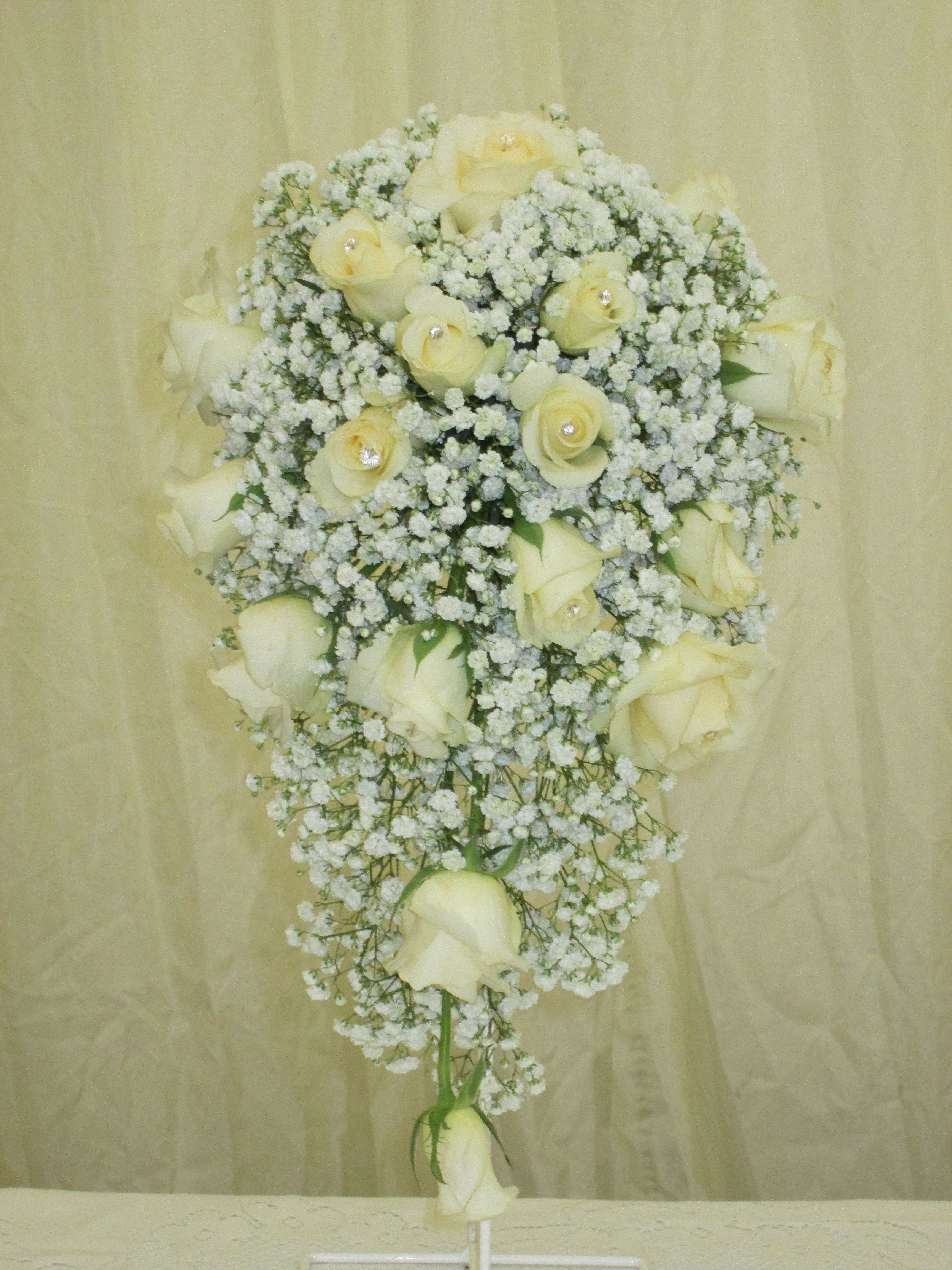 Cascade bouquet of gyp with ivory spray roses | Special Occasion ...