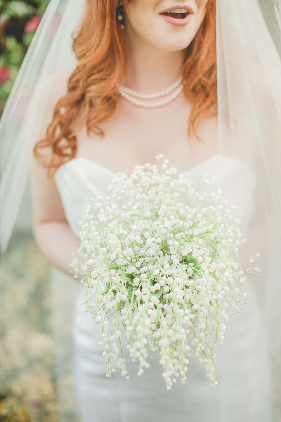 Simple and splendid white bouquet full of baby's breath!