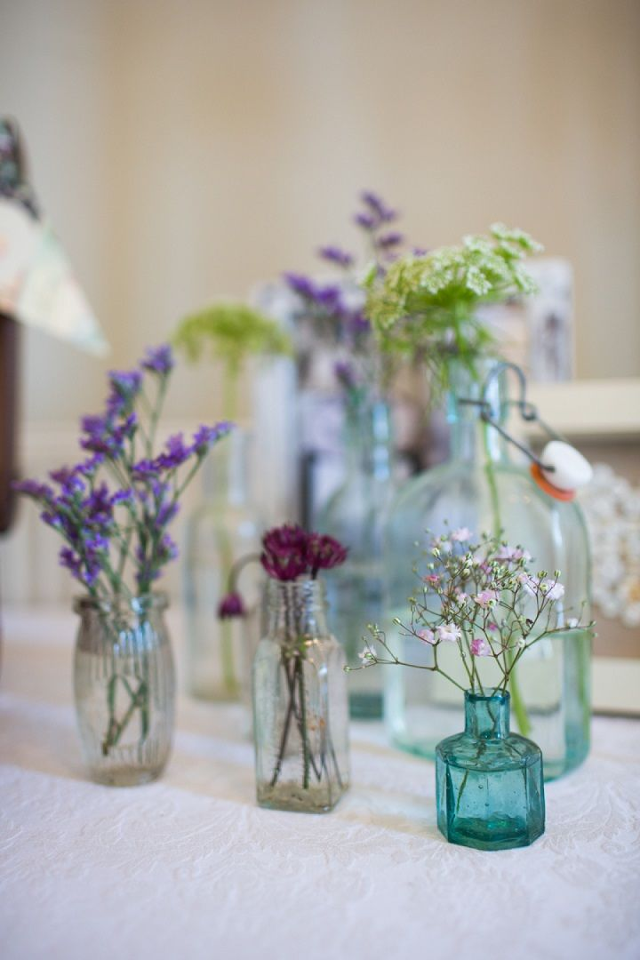 Unique wedding reception ideas on a budget – table centerpieces using different colored bottles