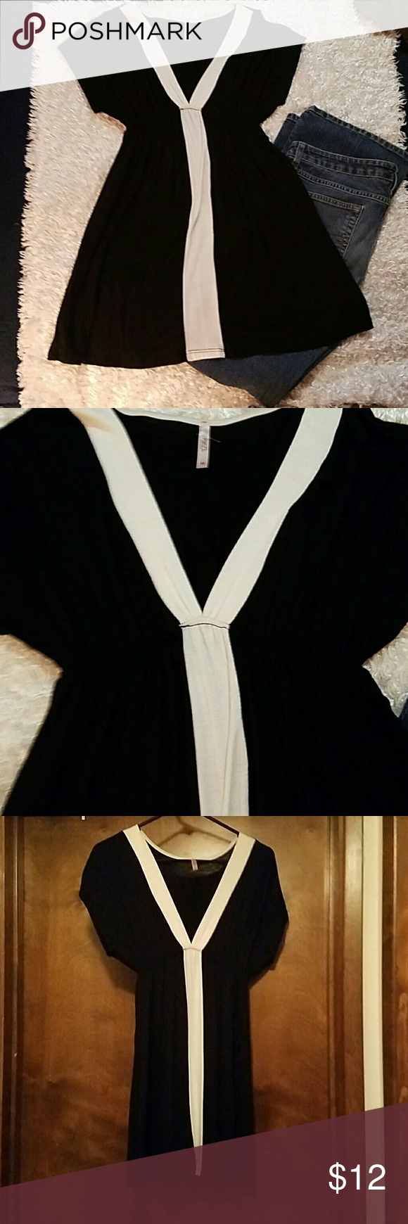 Rue 21 Women's long blouse NWOT-Super cute longer shirt. Can be worn w/ jeans or leggings. Can even be worn as a dress. Never worn Rue 21 Tops Blouses