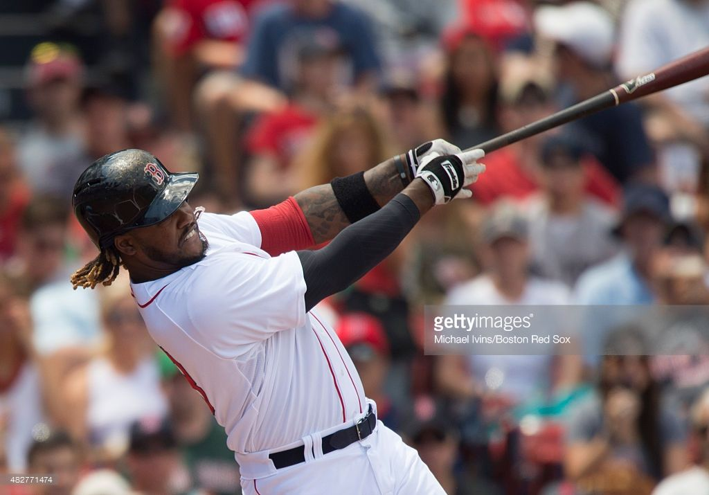 Hanley Ramirez #13 of the Boston Red Sox hits an RBI double against the Tampa Bay Rays during the first inning at Fenway Park on August 2, 2015 in Boston, Massachusetts.