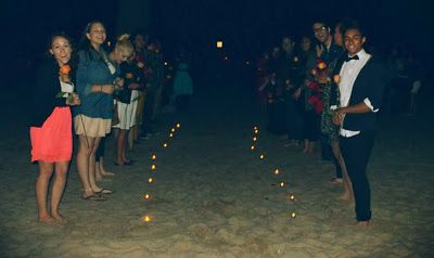 Line a pathway with candles on the beach