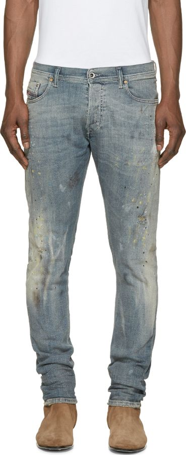 9152f60ca6 Relaxed-fit jeans in blue. Fading and distressing throughout. Multi-color  paint and bleach splatters throughout. Five-pocket styling with logo flag  at coin ...