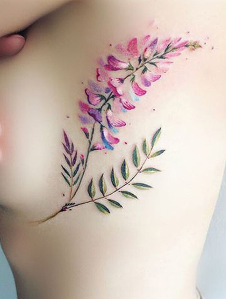Watercolor Floral Flower Rib Tattoo Ideas for Women – www.MyBodiArt.com