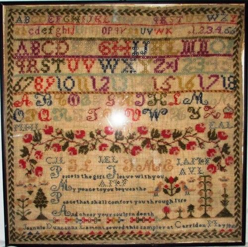"""19th century English needlepoint sampler by Jeannie Duncanna Lamont from Carriden, United Kingdom dated May 1863. The alphabet sampler's central theme is """"peace"""" as bequeathed by the Ms. Dumont."""
