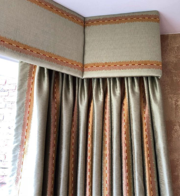 Upholstered pelmet in a bay window with matching neutral and ...