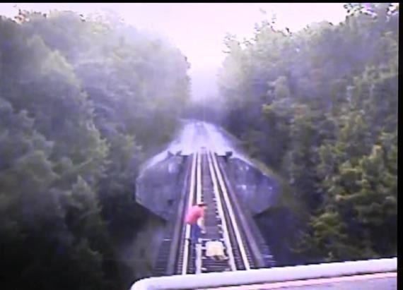2 women narrowly escape death on railroad tracks