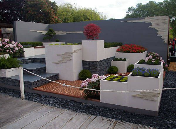 Modern garden designs on pinterest courtyard gardens for Modern garden design
