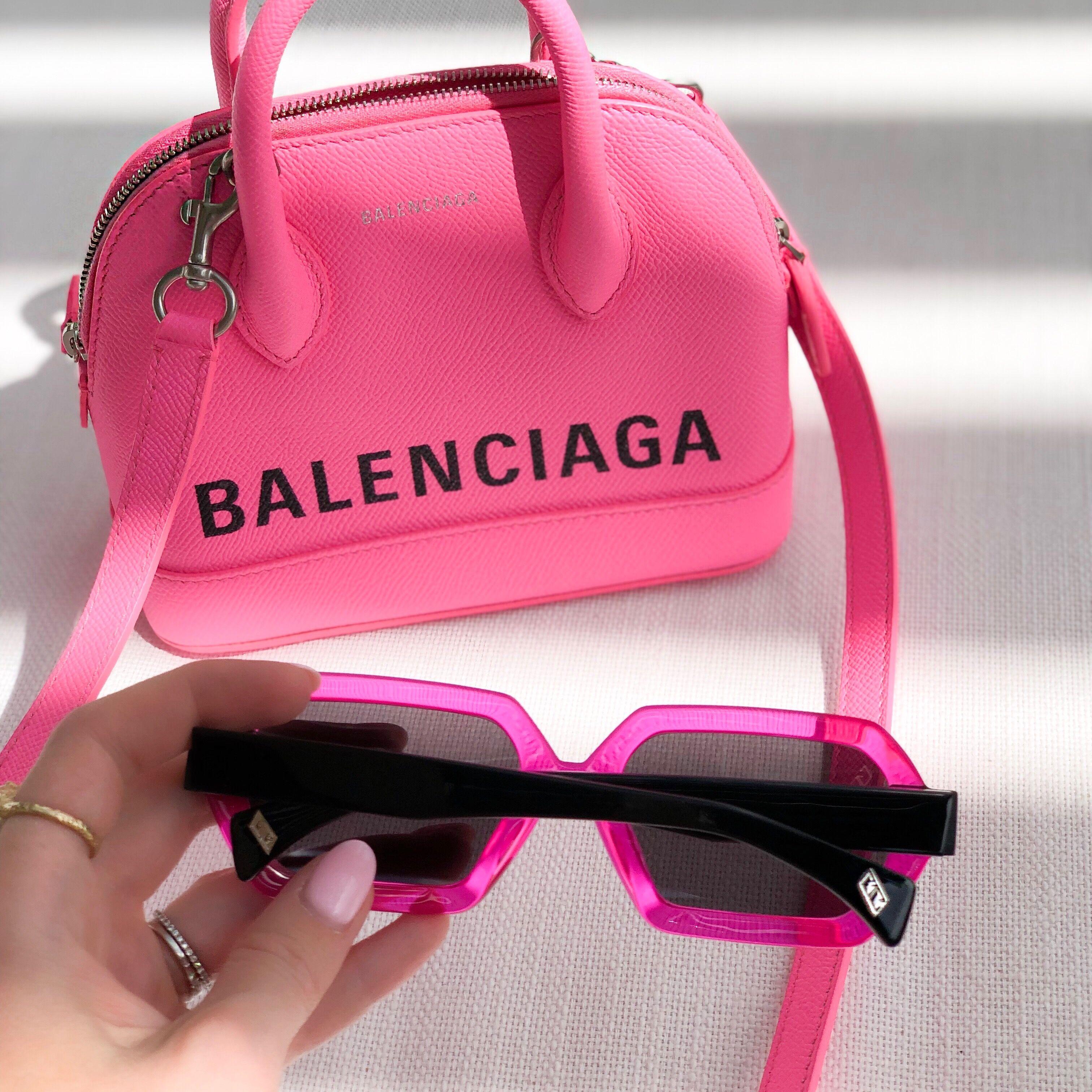 Neon pink Balenciaga bag and GEM+ELLI sunglasses