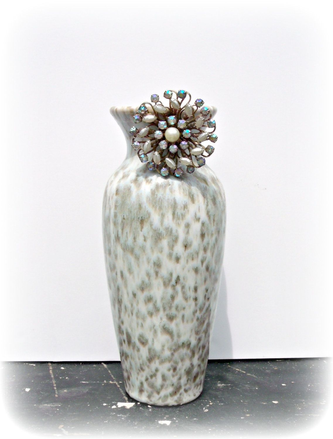 Vintage Ceramic Vase with Pearl and Rhinestone Broach- Vintage Pottery-Embellished Decor. $40.00, via Etsy.  https://www.etsy.com/listing/100311623/vintage-ceramic-vase-with-pearl-and